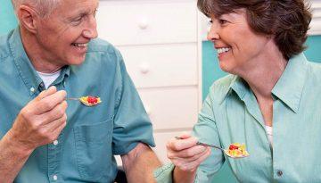 Elderly man has breakfast with Horizon Live-in carer