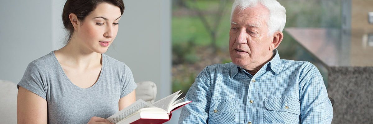 Horizon Live-in carer reads to elderly man